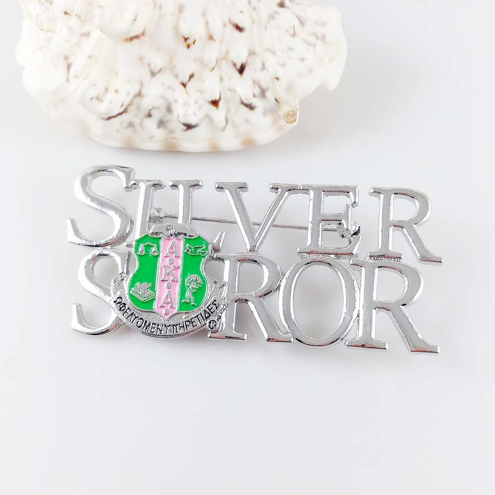 También conocido como plata Soror solapa Pin broche