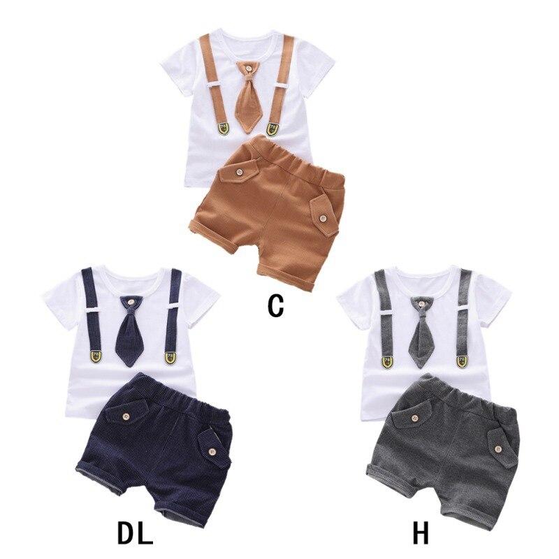 Nuevo conjunto de ropa informal para bebés y niños de manga corta con lazo falso, camisetas, pantalones cortos, conjuntos de trajes casuales para niños