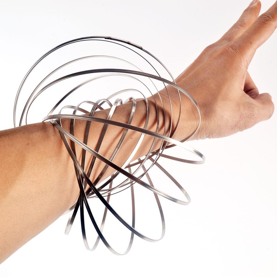 Nuevo Spinner de acero inoxidable, juguete mágico antiestrés, anillos de Flow, juguetes, patrón de ejercicio, pulsera fluida, descompresión P