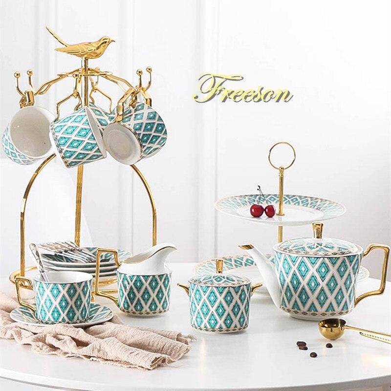 Juego de Café Chino de hueso pintado de oro, juego de té de porcelana de lujo, Taza de cerámica avanzada, tazón de azúcar, jarra de leche, tetera