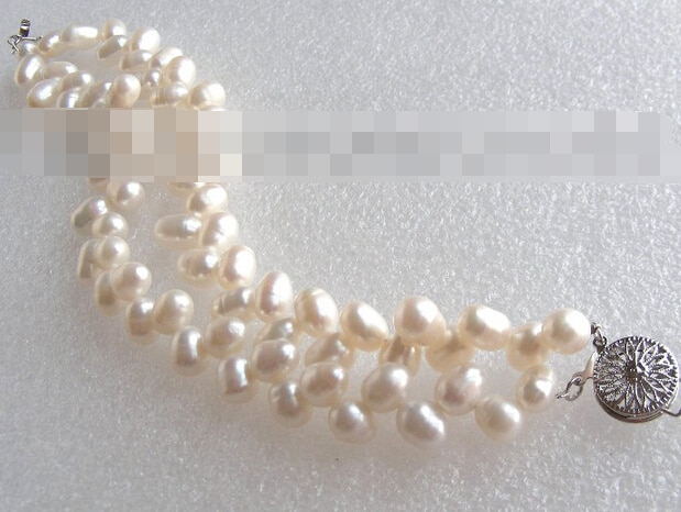 Pulsera de perlas nautrales blanco doble mariposa 09724