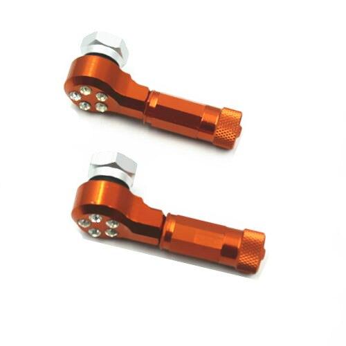 Um par de laranja cnc roda pneu válvula caule tampas da bicicleta sujeira scooter offroad moto para honda kawasaki suzuki yamaha