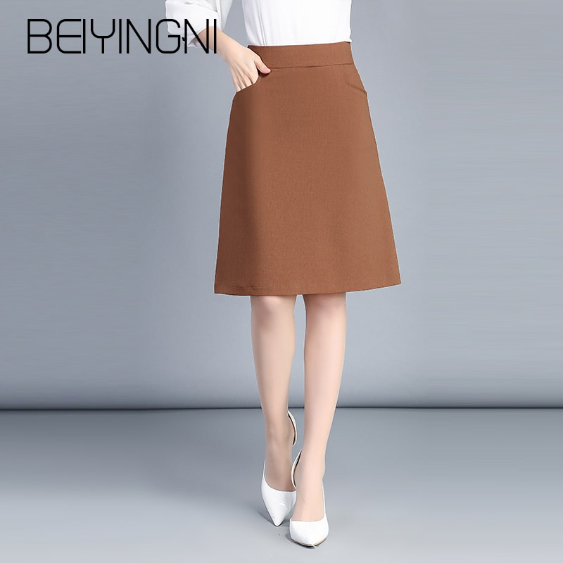 Beiyingni בתוספת גודל משרד ליידי חצאיות שחור כיסי אלסטיות גבוהה מותניים חצאית OL קוריאני עבודה ללבוש Midi חצאיות אופנה בגדים