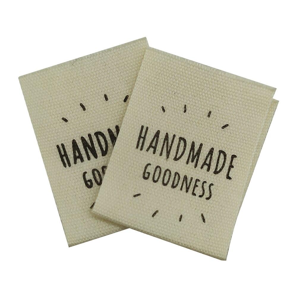 50 pçs/lote estoque feito à mão bondade adesivo impressão de algodão etiquetas com centro dobra para roupas de algodão artesanal etiqueta costura tags