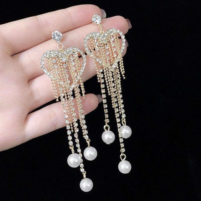 2019 nouveauté en alliage de Zinc ethnique goutte deau femmes balancent longues franges perles boucles doreilles femelle coréenne chaîne bijoux pour femme