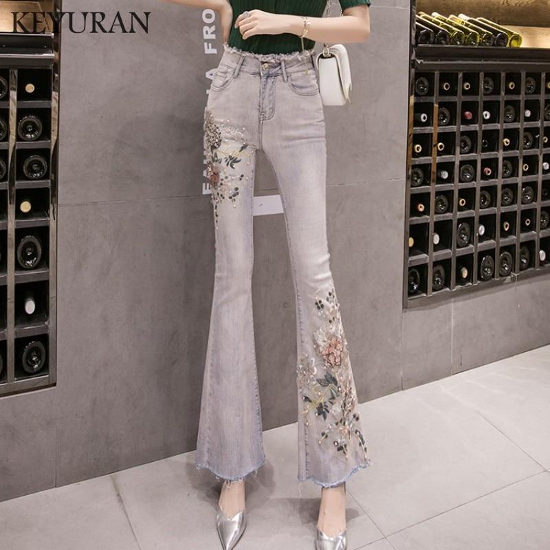 سراويل جينز نسائية مرنة عالية الخصر ثلاثية الأبعاد مطرزة بالزهور مزخرفة باللؤلؤ سراويل طويلة للسيدات جينز ضيق غير رسمي سراويل مضيئة