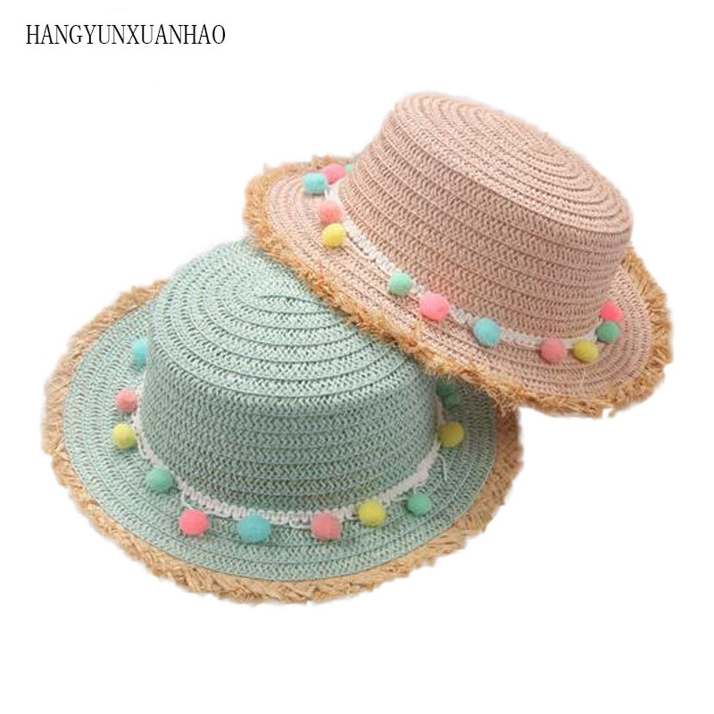 Nuevo niño verano Panamá sombreros de sol coloridos bolas de borla sombrero de paja adorable niños Niña de ala ancha gorra de playa tapa plana visera Sombreros