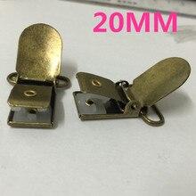 50 pièces/lot 20mm métal Antique Bronze ton crochet bébé factice porte-sucette Clips jarretelle pince sucette clips pour ruban