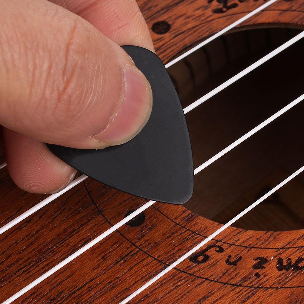 100 Uds profesional de la guitarra púas para guitarra Accesorios para Instrumentos Musicales conjunto