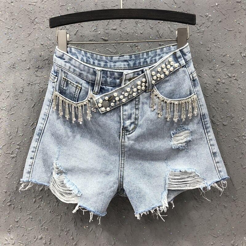 Pantalones cortos vaqueros azules de cintura alta con borlas y cadena de diamantes de imitación para mujer