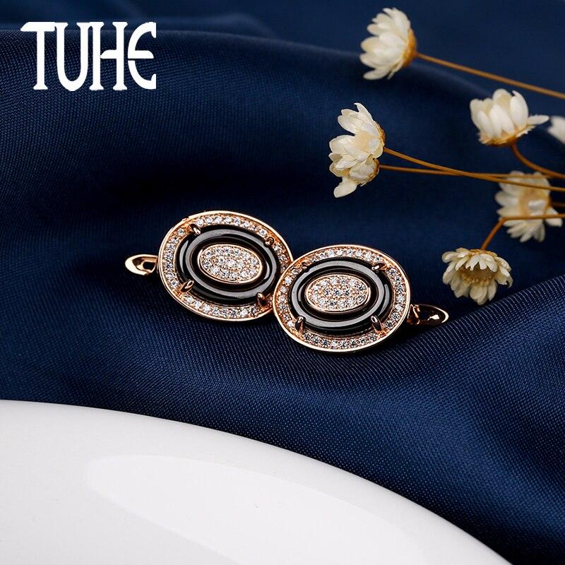 585 aretes de oro rosa ovalados pendientes en forma de U joyería saludable negro cerámica brillante cristal Zirconia pendientes para las mujeres regalos de señora