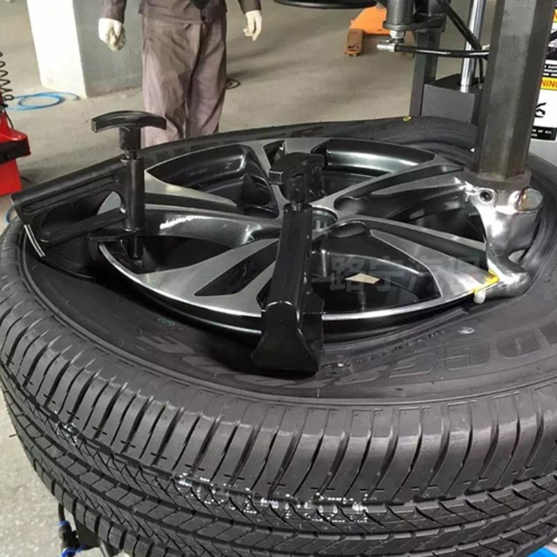 Nouveau haute qualité 1 Pc Auto voiture pneu changeur perle pince goutte Center outil universel jante levier changement de roue aide