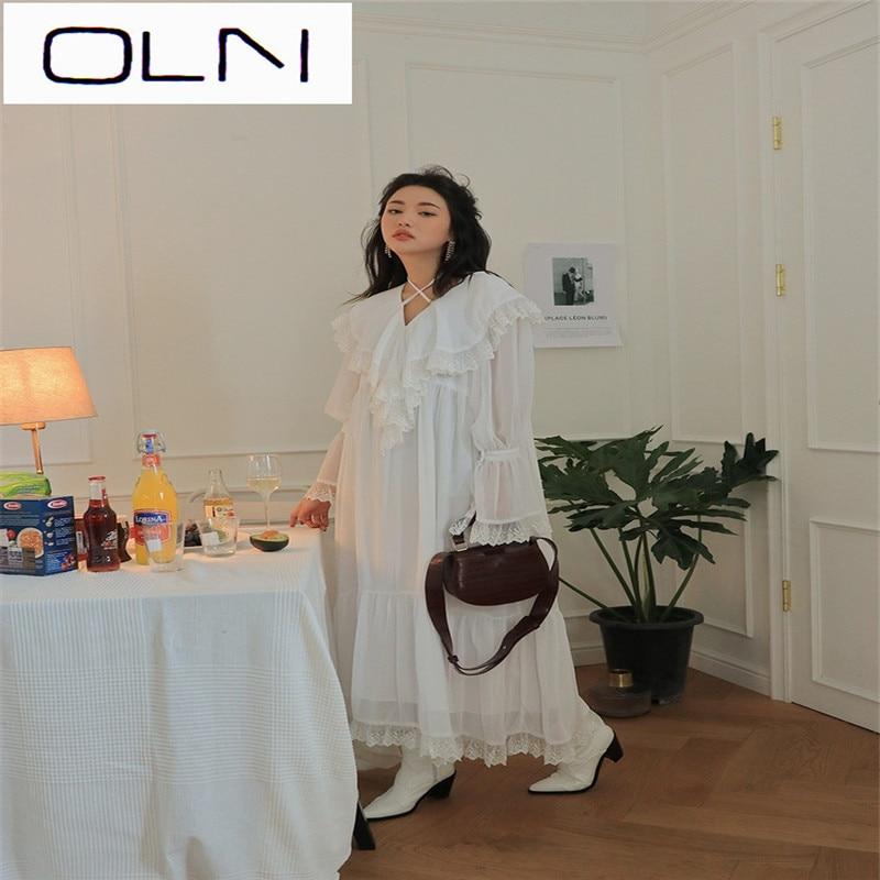 Primavera 2019 versión coreana de Súper Hada temperamento suave viento vestido de encaje con volantes Cruz cuello pico vestido largo Mujer