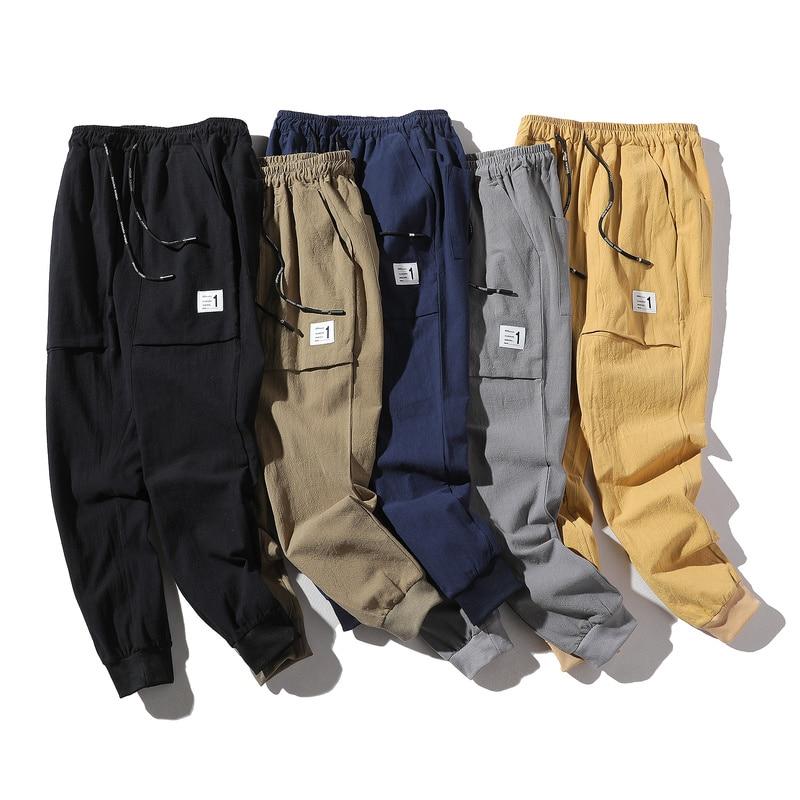 100% algodón Lino Casual pantalones de verano para hombre nueva moda Color sólido hasta el tobillo pantalones de sección delgada para hombre pantalones de lápiz