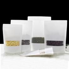 La serrure blanche de fermeture éclair de Kraft de 100 pièces tiennent des poches de sacs de nourriture avec lentaille en U et la fenêtre mate pour stocker des graines, casse-croûte et noix