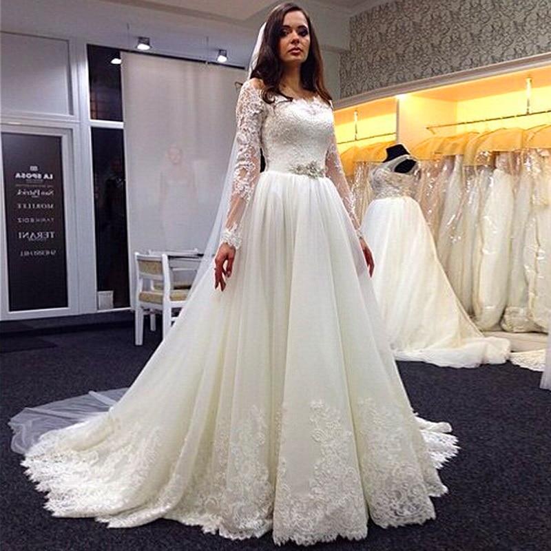 Vestidos de novia de corte A, vestidos de novia blancos con apliques de cuello redondo, vestidos de novia de encaje de manga larga baratos con banda de cuentas 2015
