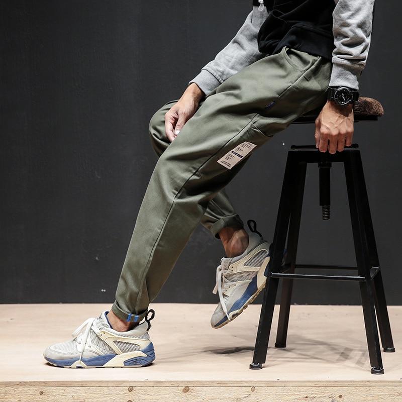 2019 nuevos pantalones cargo de moda Hip Hop sueltos bajo tobillo-longitud pantalones Skateboard Hip Hop calle alta bolsillos Haren pantalones para hombres