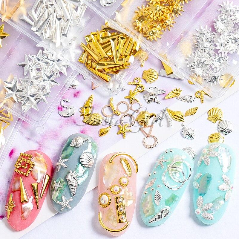 Colgantes de aleación para decoración de uñas de concha 3d de metal hueco de plata y oro Estilos mixtos para accesorios de uñas, herramientas y tachuelas