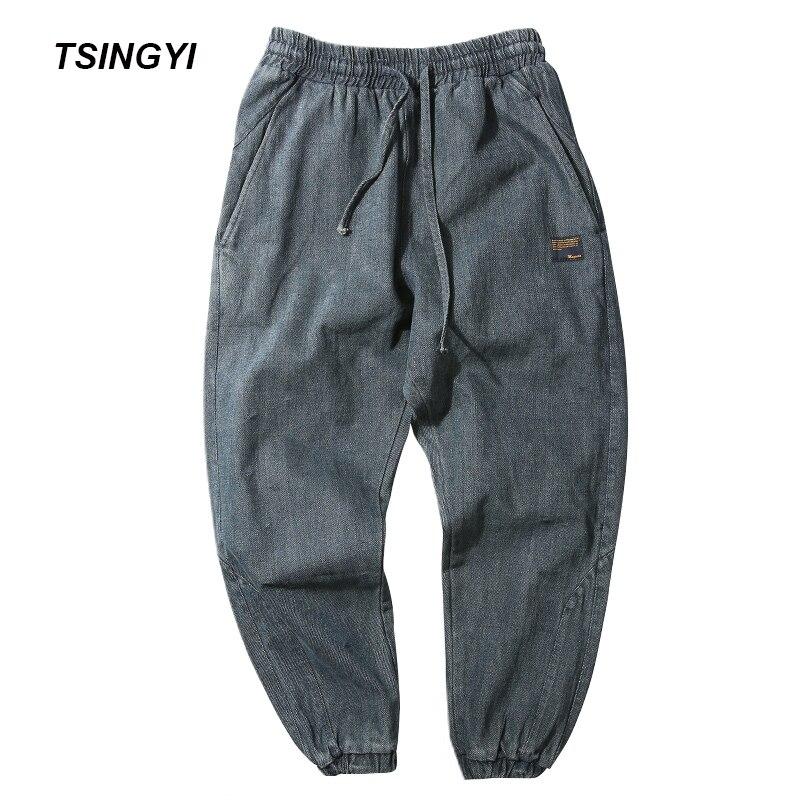 Tsingyi moda 5xl estilo japão fazer velho lavagem jeans azul preto denim dos homens corredores hip hop drawstring calças harem masculinas tamanho grande