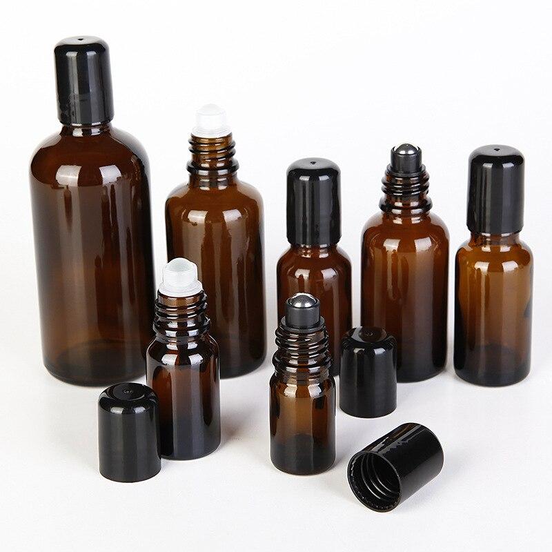 12 unids/lote rollo de vidrio ámbar en botella de aceite esencial vacía con Metal negro Rollon 5ml 10ml 15ml 20ml 30ml 50ml 100ml