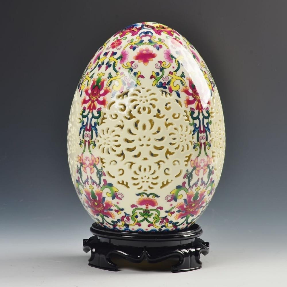 China archaize alta calidad colmillo porcelana forma de huevo ornamento talla adorno calado
