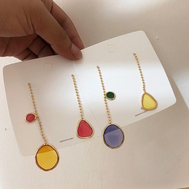 Japón y Corea del Sur nuevo diseño de moda moderna joyería de las mujeres personalidad gota de aceite largo asimétrico pendientes