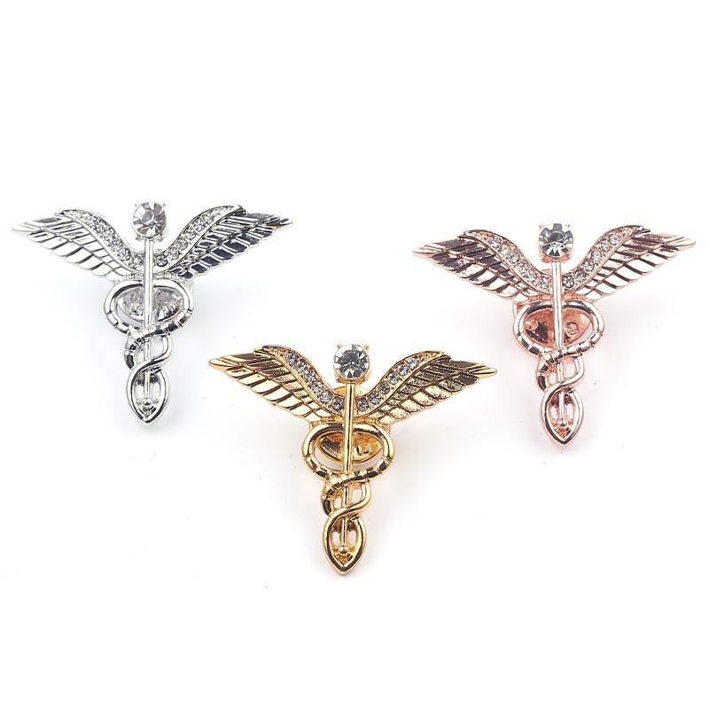 Broches con insignia de caduceo de cristal de Color dorado, Pin de solapa, símbolo de medicina, joyería, regalos para estudiantes médicos de enfermería