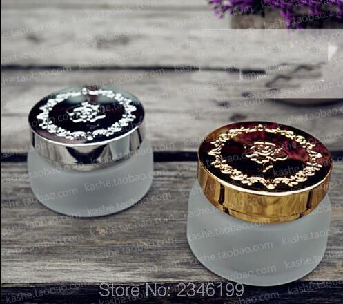 Frasco de crema de vidrio contra heladas de 30G y 50G con tapa plateada y dorada, tapa con estampado de rosas, botella de embalaje de crema cosmética de alta calidad, 15 unidades/lote