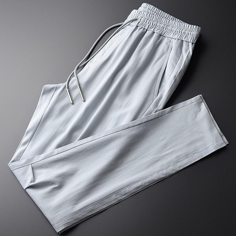 Pantalones de hombre Minglu de primavera y verano de tela Tencel de lujo gris pantalones finos para hombre de talla grande 3XL 4XL Slim Fit pantalones informales para hombre