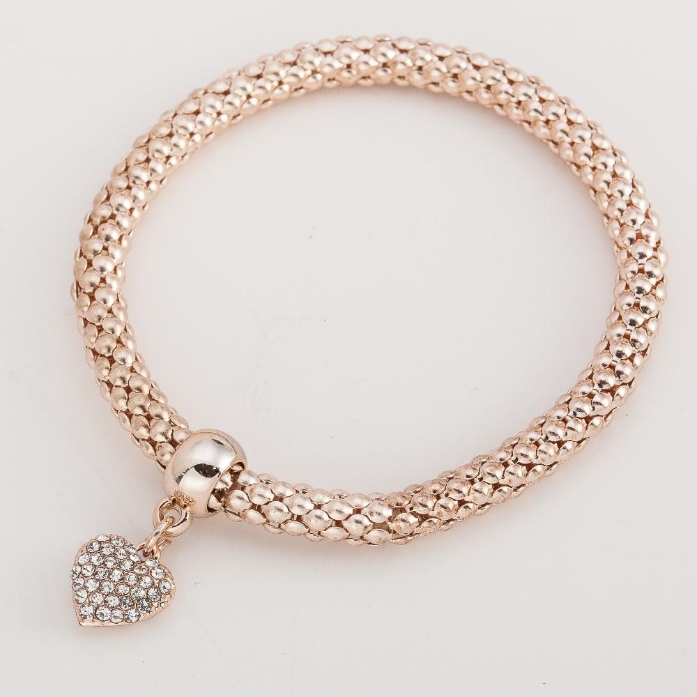 Moda urbana simple temperamento color oro rosa elástico palomitas cadena serpiente cadena lindo corazón colgante cristal pulsera Mujer