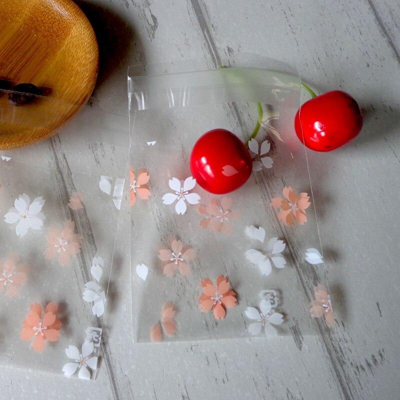 300 pcs 7x7 + 3 cm flores de Cerejeira Pequenos Biscoitos Sacos Auto-adesivo Saco de Celofane Transparente Flor sacos de doces