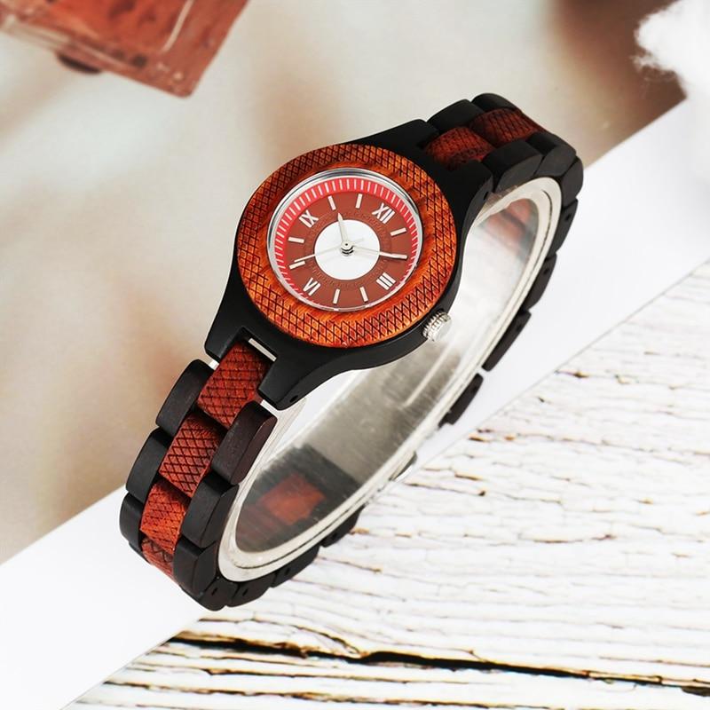 ساعة يد نسائية أنيقة جديدة ذات تصميم دائري إبداعي ساعة تناظرية من الكوارتز للسيدات سوار من خشب الأبنوس الأصلي النحيف