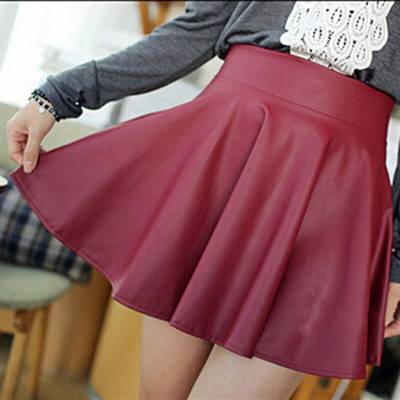 2018 otoño verano mujeres falda de cuero PU Sexy Mini Falda plisada línea de forma de a paquete cadera alta cintura mujer ropa 4 Color Cuatro tamaños