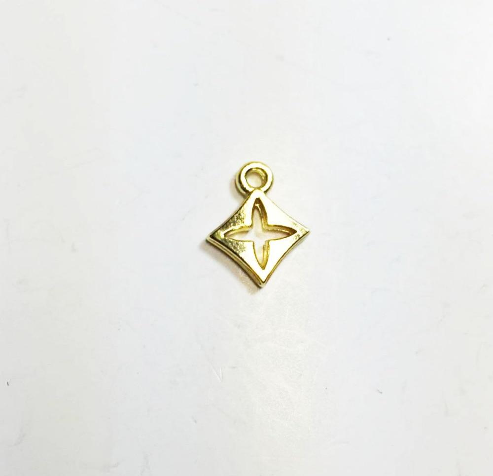 Eruifa 20pcs 8mm Pretty Hollow Open Star Cross Flower Coin Zinc alloy DIY Charms Pendant 2 Colors