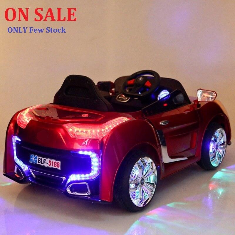 ¡A la venta! 2,4g mando a distancia doble puerta abierta niños paseo coche eléctrico de bebé cuatro ruedas de doble conducción música luz sit car