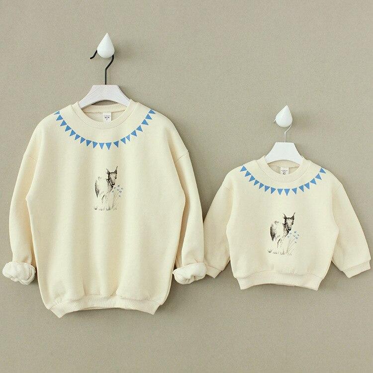 2016 coreano invierno Guoqiu blanco abrigo de algodón para niños con ciervos de Cachemira suéter de lana para niñas