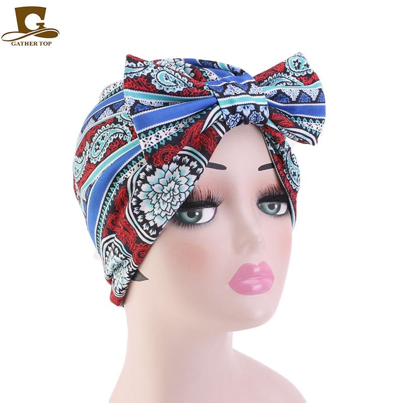 Женская эластичная трикотажная шапка с бантом