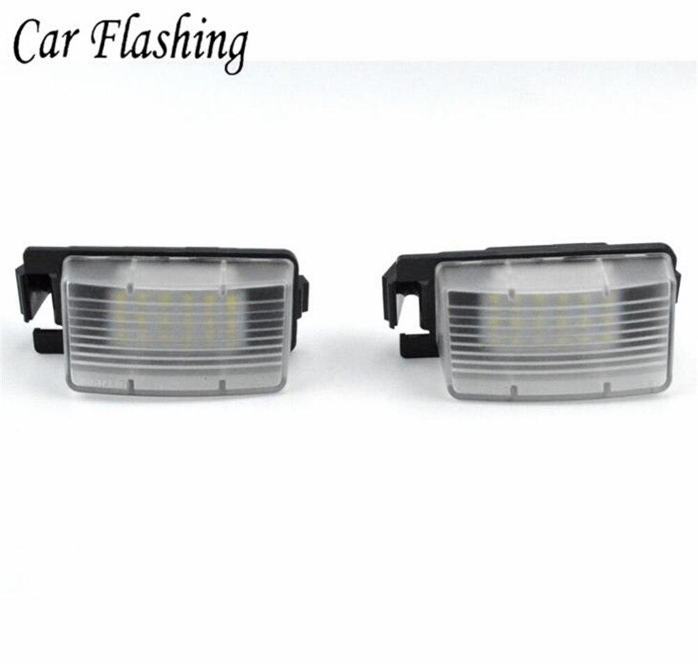 Luces de luz de matrícula LED SMD 18 3528 sin errores de 2 piezas para coche v36 G35 G37 350Z