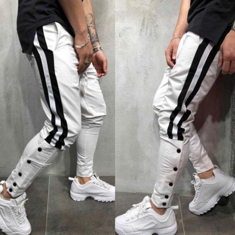 3XL pantalones de talla grande para hombre a rayas laterales Hip Hop pantalones de chándal Street Wear Skinny Elastic Waist Joggers para hombre Pantalones Casuales