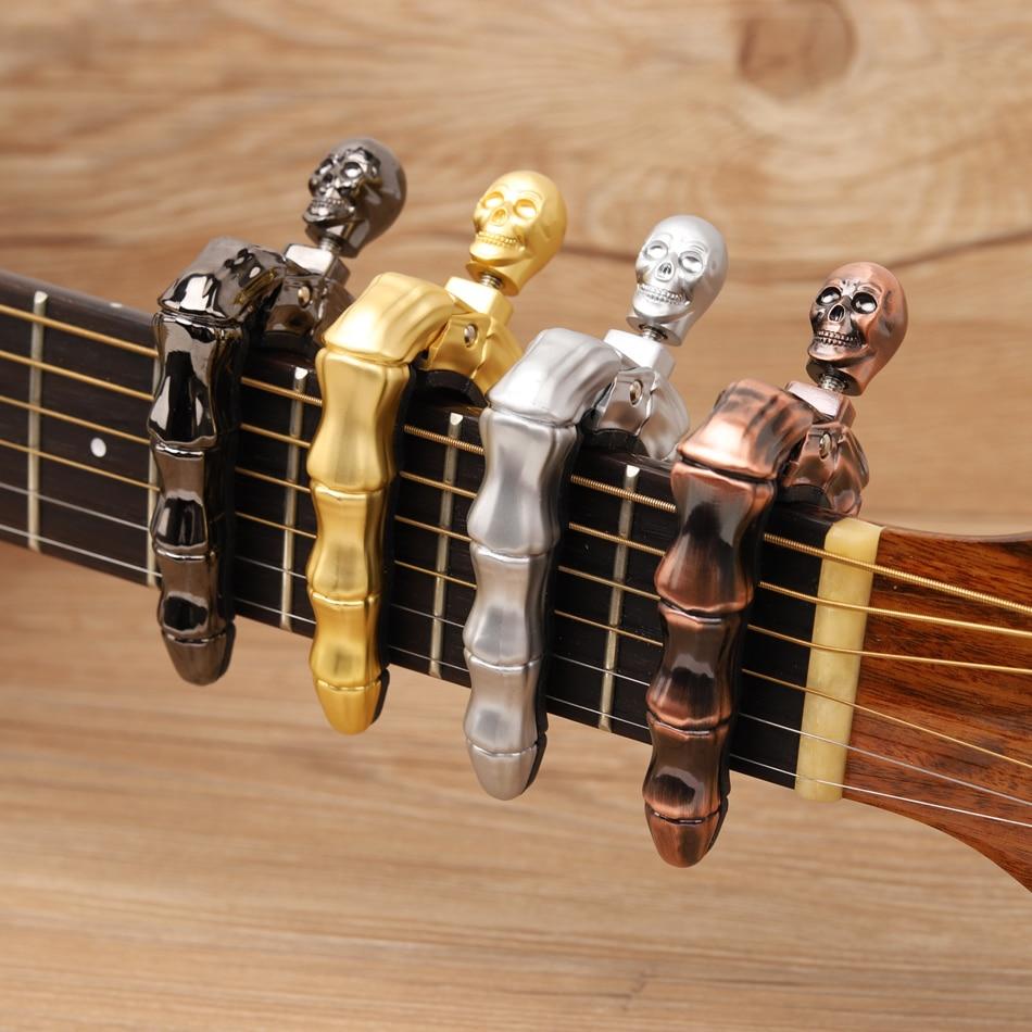 Dedos de calavera diseño Guitarra cejillas para acústicas Guitarra eléctrica ukelele piezas accesorios para Guitarra