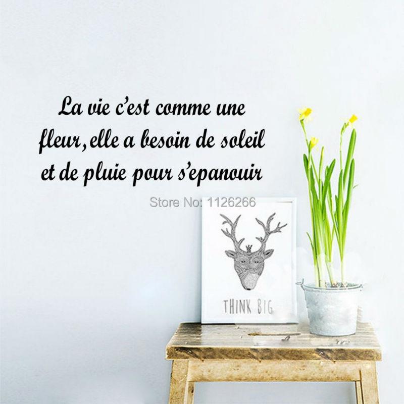 Frases francesas La Vie Est Comme Une Fleur pegatina de pared para pared de salón calcomanías vinilo arte Mural para decoración del hogar