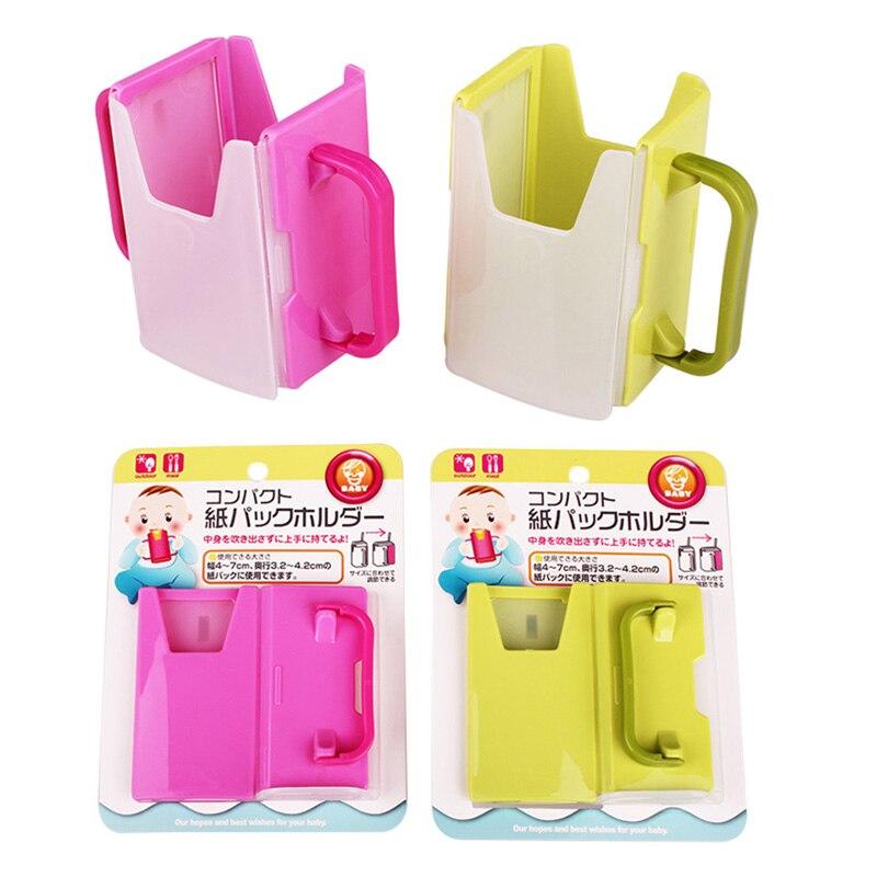 La taza de la botella de leche titular de seguridad ajustable de plástico bebé niño chico de caja de leche de botella de bebida sostenedor de taza caliente 2 colores