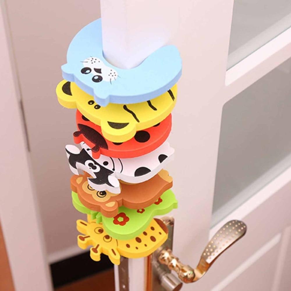 1PC bebé niños de dibujos animados de animales Jammers para protecciones de borde de esquina tapón de la puerta de bloqueo bebé seguridad Protector de dedos de Color al azar