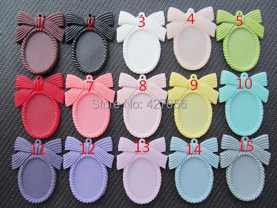 10 Uds 15 colores Oval Flatback resina Bowknot/pajarita marco encanto, filigrana borde Base ajuste bandeja, para 18x25mm cabujón/camafeo