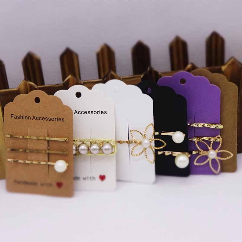 50 Uds tarjeta clip para cabello 4 colores negro/Blanco/Kraft/púrpura joyería cartón nuevo diseño Venta caliente logotipo personalizado necesita pagar Extra