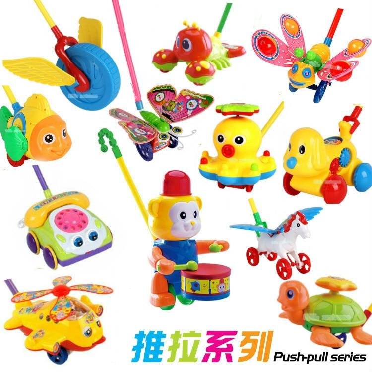 New Baby Walker Toy Hand Push Pull Walks Plane Rod Push Cart Single Rod Blink Eyes Drag Tongue Toddler Walking Toys Color Random