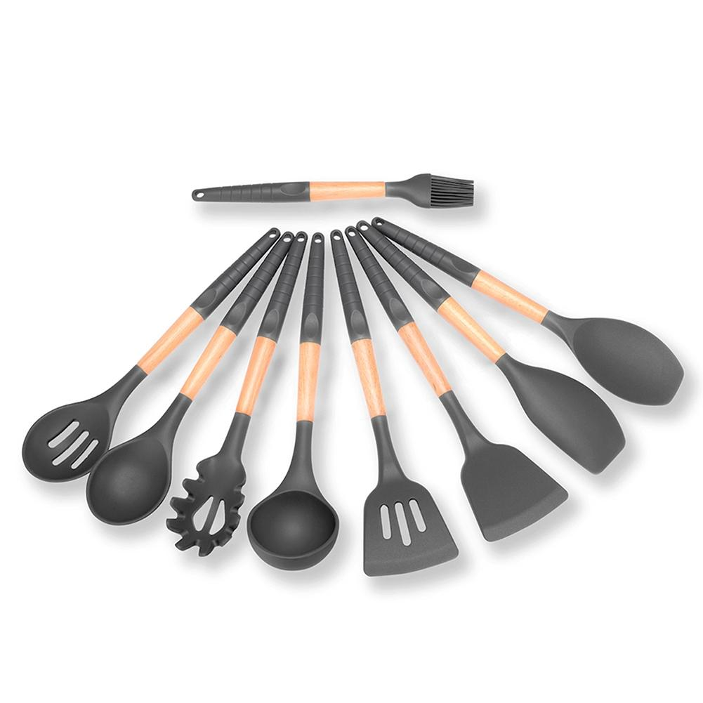 Juego de utensilios de cocina de silicona con mango de madera antideslizante utensilios de cocina exquisitos