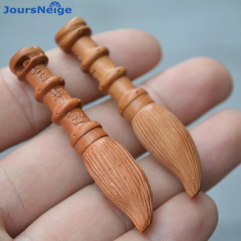 Venta al por mayor sándalo negro melocotón tallado grabado pluma wenchang bricolaje tejidas a mano colgante accesorios de madera de cepillo colgante de joyería