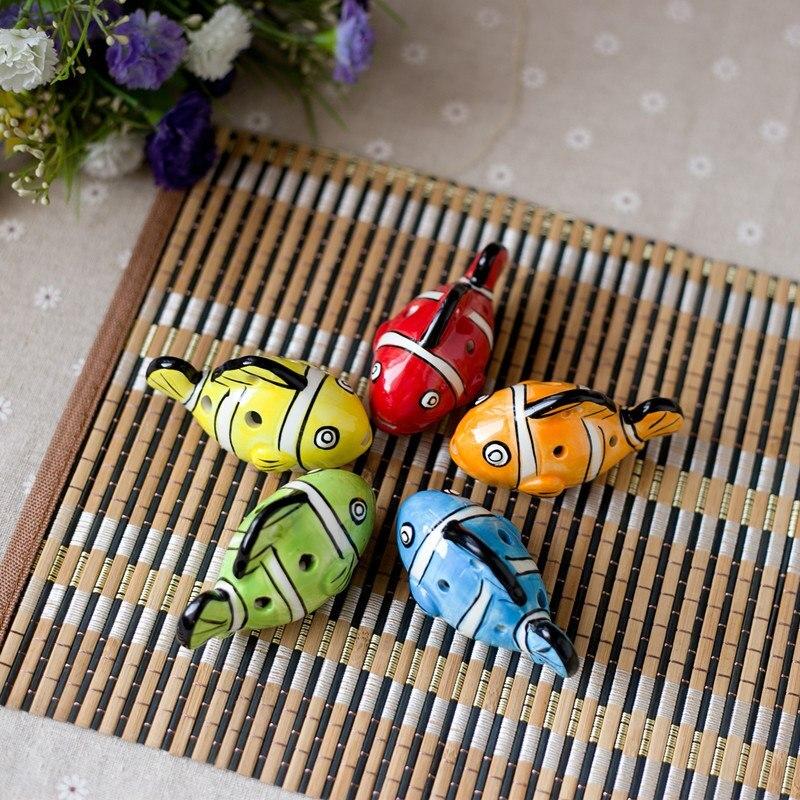 Flauta Tao, venta al por mayor, modelado de pequeños peces de dibujos animados ocarina, múltiples patrones de atracciones para turistas en puestos al por mayor