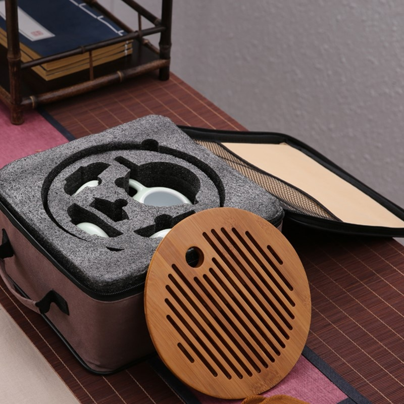 Celadon quick drink Kung Fu tea set travel outdoor portable tea set package bag with bamboo tea tray